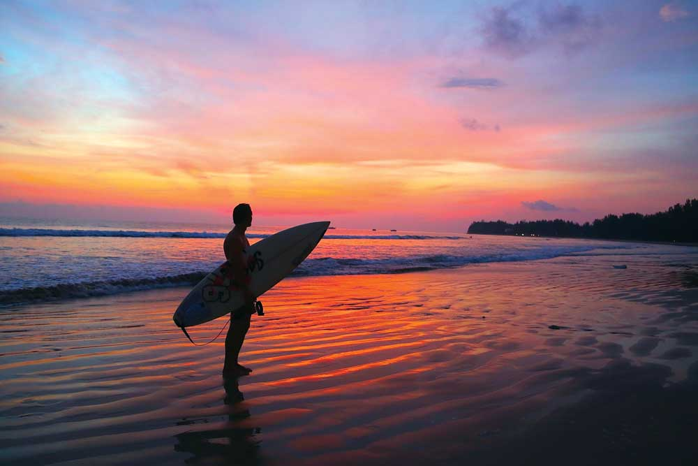 Khao Lak surfer at sunset