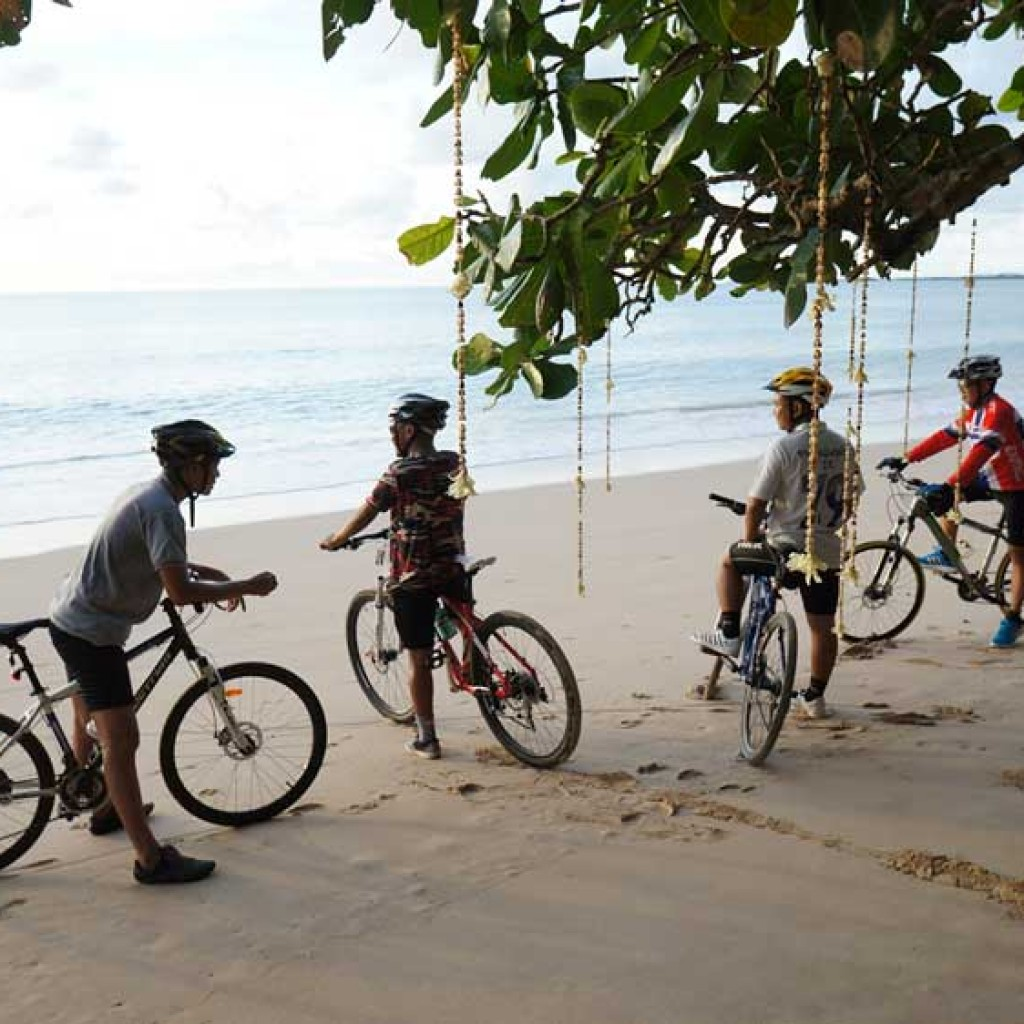 cyclists on the beach in Khao lak
